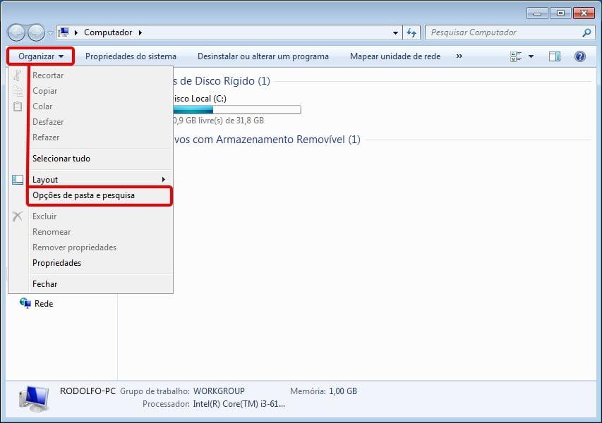 Clique na opção Organizar e selecione Opções de pasta e pesquisa para ocultar arquivos ou pastas no Windows 7.